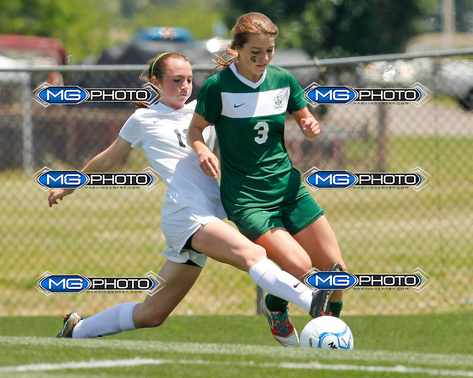 May 10, 2014; Huntsville, AL, USA;  Oak Mountain Monica Lucy Thrasher (13) pushes the ball away from Mountain Brook Carlin Pittman (3) during the 6A State Girls Soccer Championship at John Hunt Soccer Complex. Mandatory Credit: Marvin Gentry