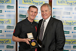 LIVERPOOL, ENGLAND - Friday, November 26, 2010: Boxer Tom Stalker with his Commonwealth lightweight Boxing Bronze Medal and Joe Royal during a Health Through Sport Charity Dinner at the Devonshire House. (Photo by David Rawcliffe/Propaganda)