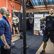 British instructor Edward Hines coaches a student during Crossfit training.