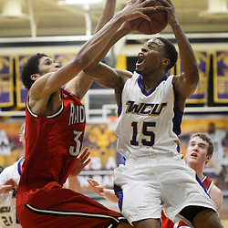 Staff photos by Tom Kelly IV<br /> West Chester's RJ Griffin (15) goes up for a Shippensburg's Marcus Williams (34) during the Shippensburg at West Chester University men's basketball game on Saturday, February 15, 2014.