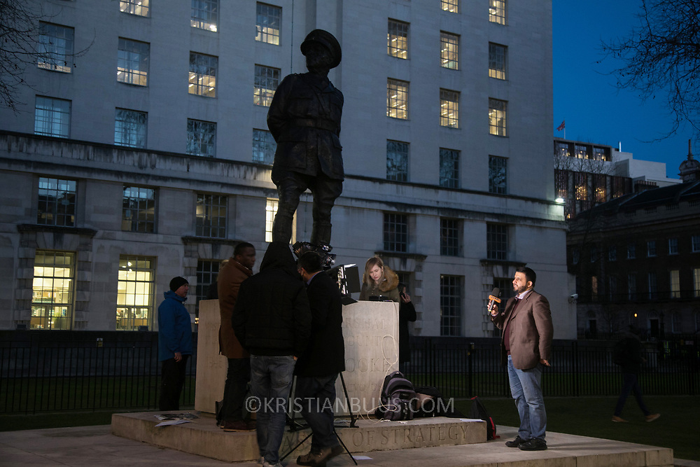 Protesters agains the visit by Saudi prince Bin Salman gather opposite Downing Street March 7th 2018 in London, United Kingdom. A tv presenter cover the event next to a statue of Field Marshal Alanbrooke. Many are angry at the Saudi involvement and continued bombing in Yemen with tens of thousands of civilian casualties and many more displaced by the war.