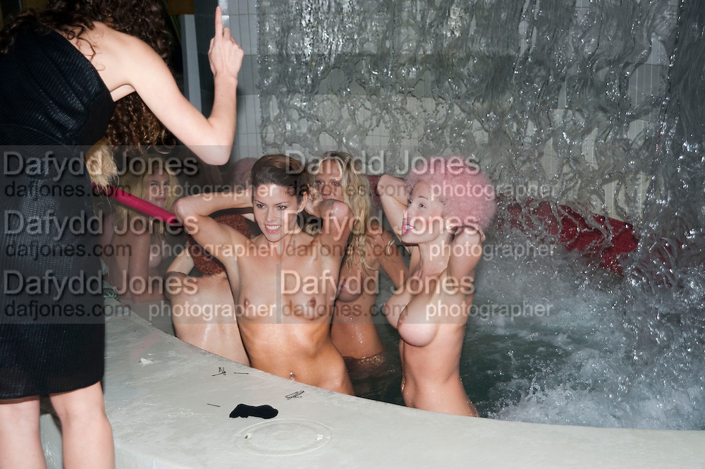 """MODELS WARMING UP IN THE HOT TUB HAVING FINISHED  VANESSA BEECHCROFT INSTALLATION, Neville Wakefield and Playboy host ÒNude as MuseÓ evening art salon. Standard Hotel.  Miami. 4 December 2010. -DO NOT ARCHIVE-© Copyright Photograph by Dafydd Jones. 248 Clapham Rd. London SW9 0PZ. Tel 0207 820 0771. www.dafjones.com.<br /> MODELS WARMING UP IN THE HOT TUB HAVING FINISHED  VANESSA BEECHCROFT INSTALLATION, Neville Wakefield and Playboy host """"Nude as Muse"""" evening art salon. Standard Hotel.  Miami. 4 December 2010. -DO NOT ARCHIVE-© Copyright Photograph by Dafydd Jones. 248 Clapham Rd. London SW9 0PZ. Tel 0207 820 0771. www.dafjones.com."""
