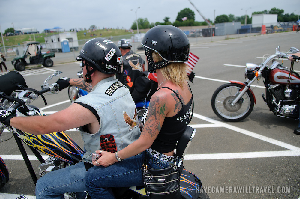 Rider with passenger participating in the annual Rolling Thunder motorcycle rally through downtown Washington DC on May 29, 2011. This shot was taken as the riders were leaving the staging area in the Pentagon's north parking lot, where thousands of bikes and riders had gathered.