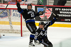 March 11 2016: Bentley Falcons forward Andrew Gladiuk (12) and Bentley Falcons forward Kyle Schmidt (20) celebrate a goal by in game one of the Atlantic Hockey quarterfinals series between the Bentley Falcons and the Robert Morris Colonials at the 84 Lumber Arena in Neville Island, Pennsylvania (Photo by Justin Berl)