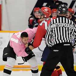 TRENTON, ON - Feb 14 : Ontario Junior Hockey League game action between the Trenton Golden Hawks and the Wellington Dukes, Shaquille Hickey #51 of the Trenton Golden Hawks Hockey Club and Maurizio Colella #27 of the Wellington Dukes Hockey Club get into an altercation during second period game action<br /> (Photo by Amy Deroche / OJHL Images)