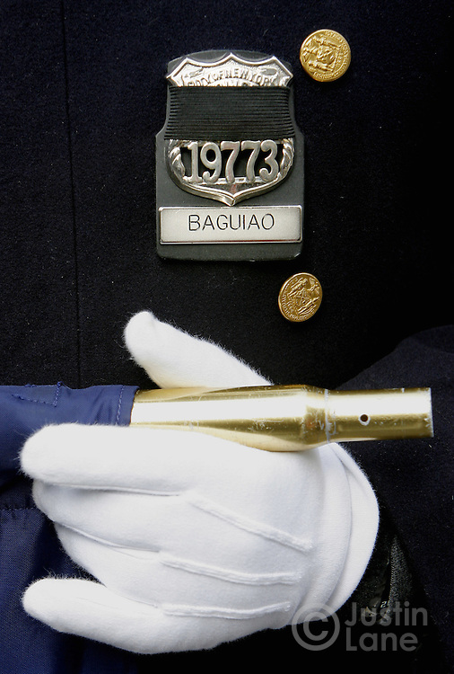 The badge of a New York City Police Officer is covered with a black band to honor the two auxiliary New York police officers killed earlier this week by a gunman during the 246th annual St. Patrick's Day parade in New York, York on Saturday 17 March 2007.