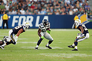 Seattle Seahawks rookie wide receiver David Moore (83) makes a cut while being chased by Los Angeles Chargers linebacker James Onwualu (49) and Los Angeles Chargers rookie cornerback Brandon Stewart (39) during the 2017 NFL week 1 preseason football game against the against the Los Angeles Chargers, Sunday, Aug. 13, 2017 in Carson, Calif. The Seahawks won the game 48-17. (©Paul Anthony Spinelli)
