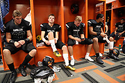 Members of the Erie Cathedral Prep Ramblers football team get ready in the locker room before the 2017 high school football game against the against the Cleveland Benedictine Bengals, Friday, Sept. 15, 2017 in Erie, Pa. The Ramblers won the game 62-28. (©Paul Anthony Spinelli)