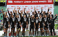 LONDON, ENGLAND - Sunday 11 May 2014, The New Zealand Sevens Team (All Blacks) hold up the London 7's winners trophy after they beat Australia 52-33 in the Cup final match at the Marriott London Sevens rugby tournament being held at Twickenham Rugby Stadium in London as part of the HSBC Sevens World Series.<br /> Photo by Roger Sedres/ImageSA