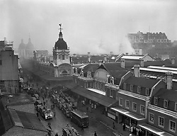 Fire engines line the road and a tangle of hoses lead away to where the blaze is at the Union Cold Storage Company at Smithfield Market, London.