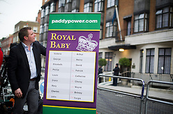 © London News Pictures. 06/12/2012. London, UK.  Paddy Power bookmakers offering betting odds on the name of the Royal baby of  Prince William and The Duchess Of Cambridge, Kate Middleton outside King Edward VII Hospital  in London, where the Duchess is currently being treated for a type of severe morning sickness called hyperemesis gravidarum. The royal couple announced the pregnancy on Monday. Photo credit: Ben Cawthra/LNP