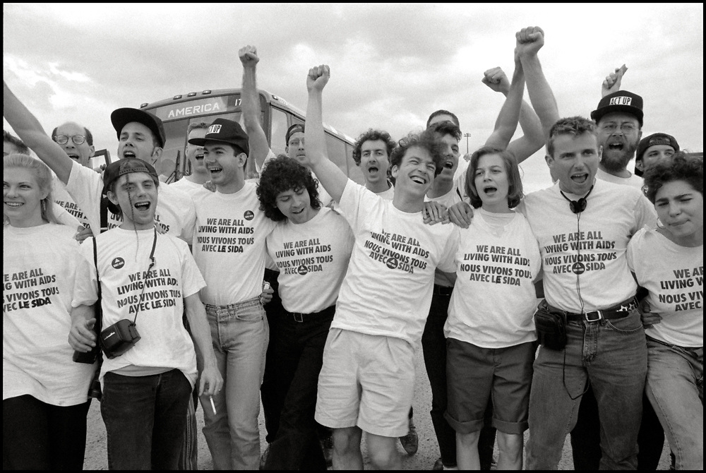 AIDS Activists from ACTUP NY en route to Montreal where they stormed the Fifth International AIDS Conference in Montreal, at the time a members-only event for doctors and HIV/AIDS researchers. They took over seats reserved for dignitaries, and released their first Treatment and Data report calling for speedier access to AIDS drugs. June 4, 1989