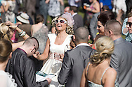 A woman race goer laughing with a group of friends.