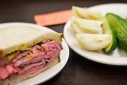 Thick roast beef sandwich and pickles at Katz's Delicatessen in Manhattan, New York.