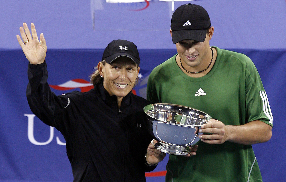 Mixed doubles partners Martina Navratilova of the Czech Republic (L) and Bob Bryan of the US (R) celebrate after winning the mixed doubles championship on the thirteenth day of the 2006 US Open tennis tournament in Flushing Meadows, New York Saturday, 09 September 2006.