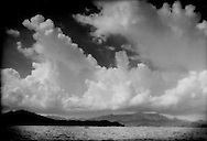 6..Clouds build over the mountains behind Coron Town on Busuanga Island, Philippines.