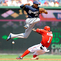 23 August 2009:  Milwaukee Brewers shortstop Alcides Escobar (21) looses the ball attempting to turn a double play on a ground ball hit by Washington Nationals shortstop Cristian Guzman as center fielder Nyjer Morgan (1) slides in safely in the 1st inning at Nationals Park in Washington, DC.  The Washington Nationals defeated the Milwaukee Brewers 8-3. ****For Editorial Use Only****