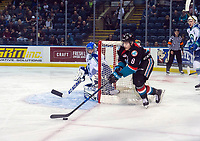 KELOWNA, CANADA - OCTOBER 23:  Jack Cowell #8 of the Kelowna Rockets skates with the puck from behind the net and tries to score a goal on Joel Hofer #30 of the Swift Current Broncos during first period on October 23, 2018 at Prospera Place in Kelowna, British Columbia, Canada.  (Photo by Marissa Baecker/Shoot the Breeze)