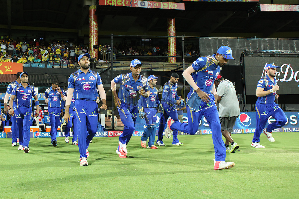 MI team entering the field during match 43 of the Pepsi IPL 2015 (Indian Premier League) between The Chennai Superkings and The Mumbai Indians held at the M. A. Chidambaram Stadium, Chennai Stadium in Chennai, India on the 8th May April 2015.<br /> <br /> Photo by:  Saikat Das / SPORTZPICS / IPL