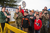 Van and Wyatt Buhrman are surrounded by family and friends as their names are announced for their 3rd place White Perch 2.46 lbs (Van) and 1st place White Perch 2.86 lbs (Wyatt)  during the awards ceremony for the Great Meredith Rotary Ice Fishing Derby on Sunday afternoon at Derby Headquarters in Meredith.  Both fish were caught on Big Squam early Sunday morning.   (Wyatt) (Karen Bobotas/for the Laconia Daily Sun)