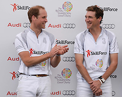 Left to right, HRH THE DUKE OF CAMBRIDGE and LUKE TOMLINSON  at the Audi Polo Challenge 2013 at Coworth Park Polo Club, Berkshire on 3rd August 2013.