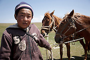 Timerbek, a boy from a herding family living on jailoo (high summer pasture) in the Baybiche-Too range of the Tien Shan mountains in Kyrgyzstan