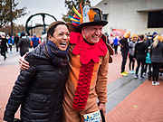 28 NOVEMBER 2019 - DES MOINES, IOWA: US Senator KAMALA HARRIS (D-CA) talks to a person in a turkey outfit in the finish area of the Turkey Trot. The Turkey Trot is an annual Des Moines Thanksgiving Day 5 mile fun run. Sen. Harris greeted runners in the finish area and handed out cookies. She is running to be the Democratic nominee for the US Presidency in 2020. Iowa hosts the first selection event of the presidential election season. The Iowa caucuses are February 3, 2020.          PHOTO BY JACK KURTZ