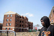 "Baltimore, Maryland - April 21, 2015: Kevon Starke, 20, was detained earlier in the day for jay walking. He was a friend of Freddie Gray -- his friends called Gray ""Pepper."" <br /> Greene is photographed in the West Baltimore neighborhood where Freddie Gray was detained by police, and suffered lethal injuries. <br /> <br /> CREDIT: Matt Roth for The New York Times<br /> Assignment ID: 30173645A"