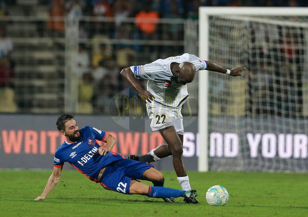 Joffre Gonzalez of FC Goa tackles Mohd Sissoko of FC Pune City during match 8 of the Indian Super League (ISL) season 3 between FC Goa and FC Pune City held at the Fatorda Stadium in Goa, India on the 8th October 2016.<br />