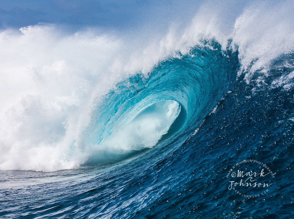 Tubing wave at the famous Teahupoo surf break, Tahiti, French Polynesia