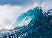 Tubing wave at the famous Teahupoo surf break, Tahiti, French Polynesia