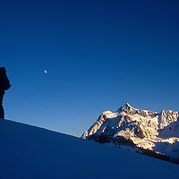 Marshall Balick ski tours in the Mt. Baker backcountry with Mt. Shuksan in the distance.