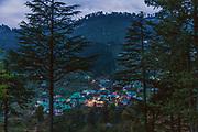 Evening view of Bakralu Devta Temple with Dalgaon village in Spail Valley of Rohru, Shimla, Himachal Pradesh, India