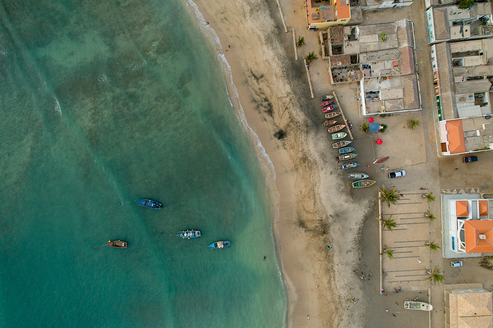 Drone photography of fishing boats on the sand and the sea on Maio Island in Cape Verde.