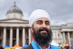 © Licensed to London News Pictures. 29/04/2017. London, UK. Jujhar Singh of Gurmat Sangeet Academy is part of the entertainment at the Sikh festival of Vaisakhi taking place in Trafalgar Square and hosted by the Mayor of London.  The festival celebrates the beginning of Sikhism, a collective faith which is practiced by more than 20 million people worldwide.   Photo credit : Stephen Chung/LNP