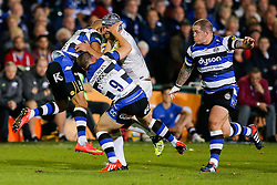 Saracens Lock Alistair Hargreaves (capt) is tackled by Bath Winger Olly Woodburn and Scrum-Half Chris Cook - Photo mandatory by-line: Rogan Thomson/JMP - 07966 386802 - 03/10/2014 - SPORT - RUGBY UNION - Bath, England - The Recreation Ground - Bath Rugby v Saracens - Aviva Premiership.