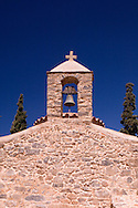 The small stone Byzantine Church of Agios Nikolaos on the grounds of the Minos Palace Hotel near the town of Agios Nikolaos, Crete, Greece