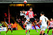 Port Vale's Richard Duffy and Exeter City's Jamie Reid fight for a cross during the The FA Cup match between Exeter City and Port Vale at St James' Park, Exeter, England on 6 December 2015. Photo by Graham Hunt.