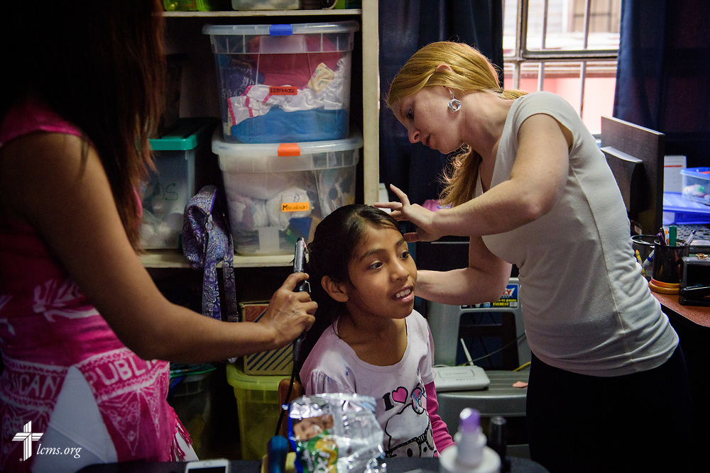 Deaconess Caitlin Worden de Ramírez, LCMS career missionary to Peru, does Victoria's hair as they prepare for the young lady's confirmation at Castillo Fuerte on Saturday, Nov. 4, 2017, in the La Victoria district of Lima, Peru.  LCMS Communications/Erik M. Lunsford