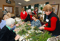 Members of the Opechee Garden Club put together approximately 90 floral arrangements for special delivery to the Belknap County Nursing Home residents on Tuesday afternoon.  (Karen Bobotas/for the Laconia Daily Sun)