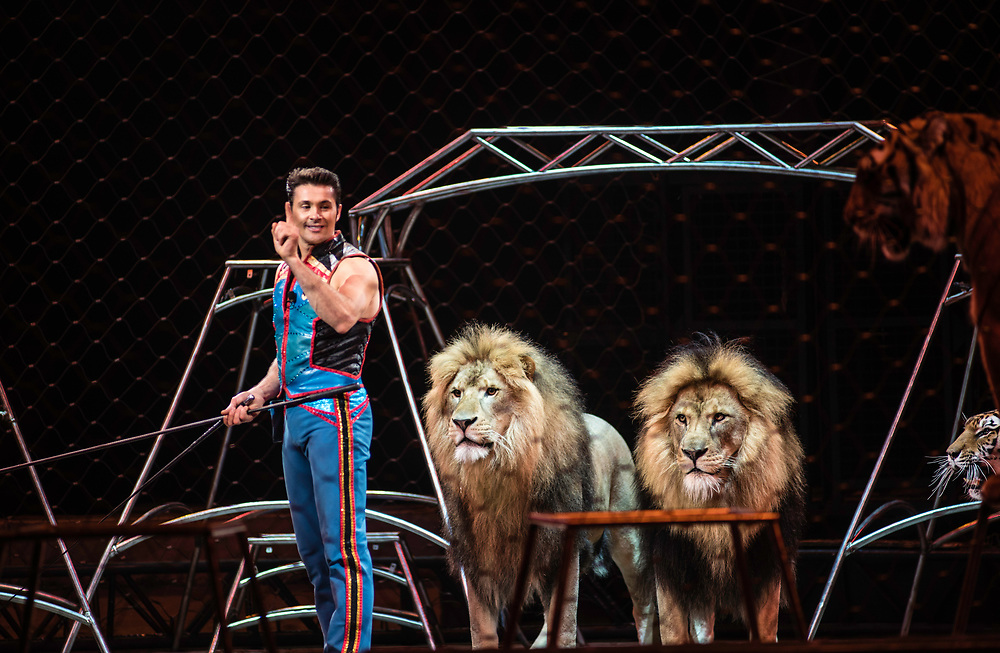 BALTIMORE, MD -- 4/21/17 -- Big Cat Trainer Alexander Lacey comes from a family of animal trainers. Ringling Bros, the self-proclaimed Greatest Show on Earth, is in the final leg of a 146 year run. The final performances will be held in May. Out of This World, one of two circus units, recently had performances in Baltimore, led by Jonathan Lee Iverson, the first African-American ringmaster in the show's history…by André Chung #_AC27682