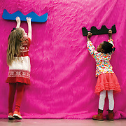 "March 10, 2012 - New York, NY : Museumgoers, from left, Ella Gershon, 5, and Jordyn Taylor, 4, use oversized combs to rake the pink faux fur of Misaki Kawai's giant dog as they explore Kawai's ""Love from Mt. Pom Pom,"" exhibit, at the Children's Museum of the Arts in the south village  on March 10. CREDIT: Karsten Moran for The New York Times"