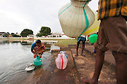 Local villagers collect water in Kanadukathan from an 'ooranis'. Ooranis is a Tamil word for water storage tank and contains rain water that is boiled then filtered for drinking. Numbering more than 25,000, Chettinad's mansions were built by a Hindu caste of Chettiars called the Nagarathars. They were bankers and merchants who made their fortunes outside India in Burma, Malaysia, Vietnam and Singapore during the times of the British colonialism. With this new found fortunes they built mansions, exquisite palaces that rivaled those of even the Maharajah's using teak from Burma, marble form Italy, tiles from Japan and steel from England. But these glory days only lasted until after the WWII when the British left Burma and they were forced to leave return to India. Suddenly with no income their mansions began to decay and fall down or were pulled take and the pillars, windows, doors and antiques were sold. Some estimates say that around 20 per month are coming down. Hopefully, with the aid of preservation projects such as the Revive Chettinad Society, and the influx of tourism these mansions can be saved before they all fall down.