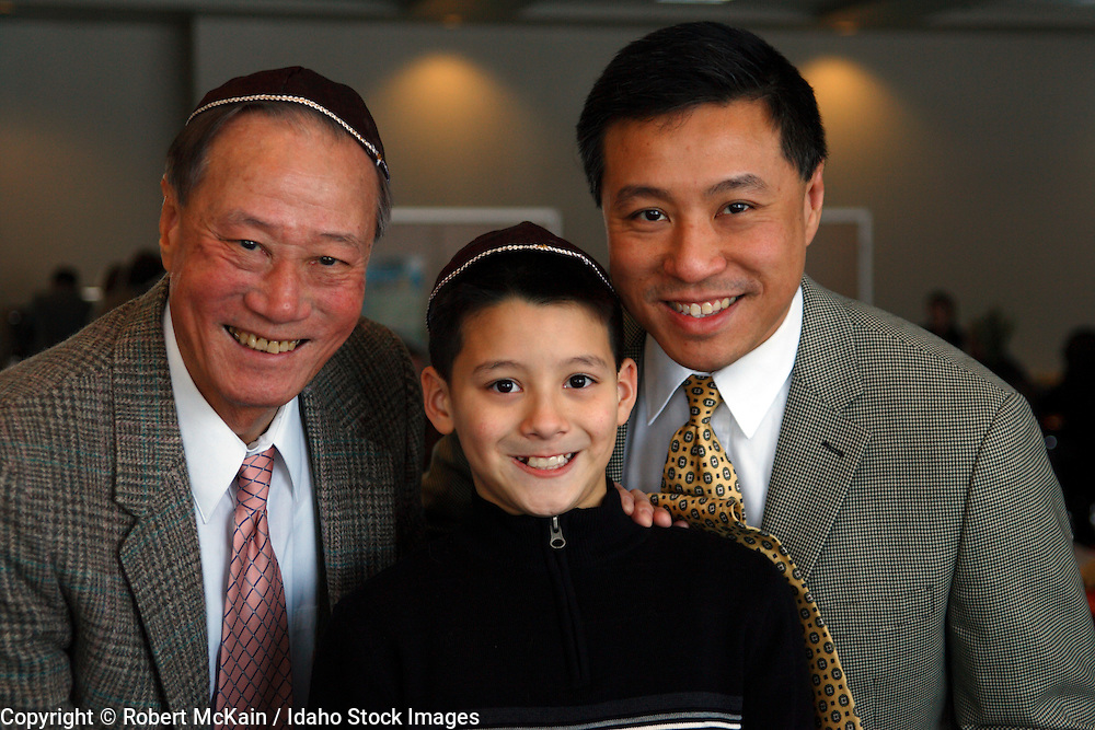 IDAHO. Boise. Asian Jewish boy with father and grandfather. December 2008. #pa080748 MR