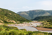 White iMfolozi River and rolling aloe covered hillsides, Babanango Game Reserve, KwaZulu Natal, South Africa