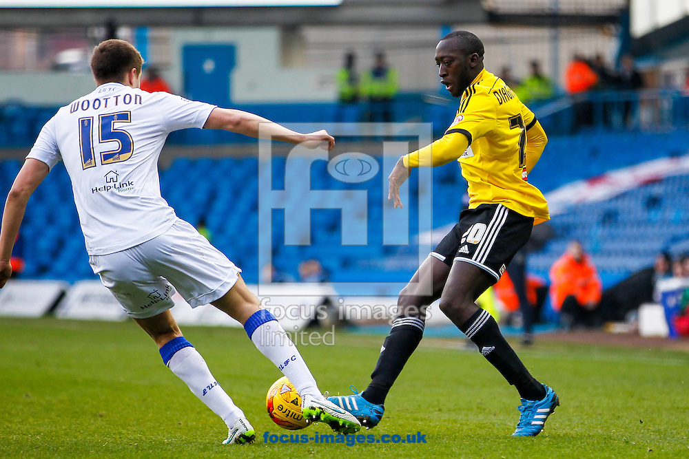 Scott Wootton of Leeds United and Toumani Diagouraga of Brentford during the Sky Bet Championship match between Leeds United and Brentford at Elland Road, Leeds<br /> Picture by Mark D Fuller/Focus Images Ltd +44 7774 216216<br /> 07/02/2015
