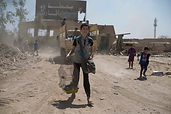 © Licensed to London News Pictures. 15/06/2017. Mosul, Iraq. A young Mosul resident carries his pet bird in a cage after escaping from ISIS held West Mosul shortly before this picture was taken.<br /> <br /> Despite heavy fighting between the Islamic State and Iraqi Security Forces many civilians have started to leave ISIS territory in West Mosul. Mosul residents, many of whom have been in hiding in their homes since the start of the West Mosul Offensive, often have to run through ISIS sniper and machine gun fire to reach the safety of Iraqi Security Forces positions. Photo credit: Matt Cetti-Roberts/LNP