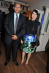 OSAMA & ABEER AL-AYOUB at a dinner hosted by Marlon and Nadya Abela in aid of Kids Company at Morton's, Berkeley Square, London on 25th September 2012.