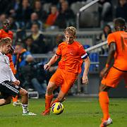 NLD/Amsterdam/20121114 - Vriendschappelijk duel Nederland - Duitsland, Dirk Kuyt in duel met lewis Holtby