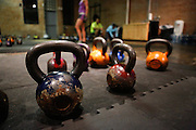 Weathered kettle bells line the floor at the Psycho Gym in Dallas, Texas, on December 20, 2012.  (Stan Olszewski/The Dallas Morning News)